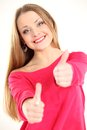 Beautiful young woman showing thumbs up sign Stock Photo