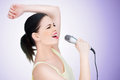 Beautiful young woman singer Stock Photography