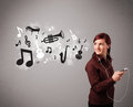 Beautiful young woman singing and listening to music with musica musical notes instruments getting out of her mouth Royalty Free Stock Images