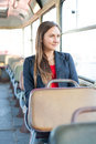 Beautiful young woman sitting in bus vintage Royalty Free Stock Photography