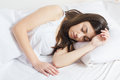 Beautiful young woman sleeping in the bed Royalty Free Stock Photo