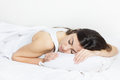 Beautiful young woman sleeping in the bed Stock Photos