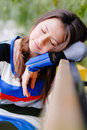 Cute teen girl sleeping on the street outdroors Royalty Free Stock Photo