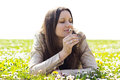 Beautiful young woman smelling flowers portrait of a Stock Photography