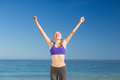 Beautiful young woman smiling while exercising Royalty Free Stock Photo