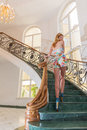 Beautiful young woman on staircase