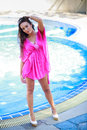Beautiful young woman standing in a swimming pool Stock Image