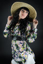 Beautiful young woman in straw hat Stock Photo