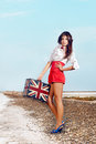 Beautiful young woman with suitcase with british flag outdoor portrait of Stock Photography