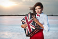 Beautiful young woman with suitcase with british flag outdoor portrait of Stock Images