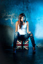 Beautiful young woman with suitcase with british flag portrait of casual metal wall as a background Royalty Free Stock Images