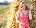 Beautiful young woman on summer dress standing in field Royalty Free Stock Photo