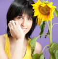 Beautiful young woman with sunflowers Royalty Free Stock Photo