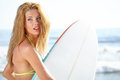 Beautiful Young Woman Surfer Girl in Bikini with Surfboard at a Royalty Free Stock Photo