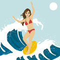 Beautiful young woman surfing on ocean waves. Blue ocean water crashing with splashes and drops