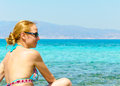 Beautiful young woman in swimsuit, relaxing on a tropical sunny beach Royalty Free Stock Photos