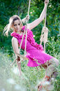 Beautiful young woman on a swing blond Stock Image