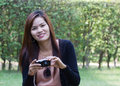 Beautiful young woman taking photos outdoors at thiland Stock Images