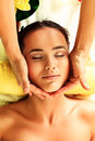 Beautiful young woman taking spa treatments at the salon Stock Photos