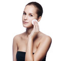 Beautiful young woman touching her face fresh healthy skin isolated on white Stock Photo