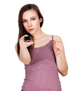 Beautiful young woman with tv remote control white background Stock Photo