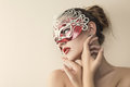 Beautiful young woman in venetian mysterious carnival mask fashion photo Stock Photos