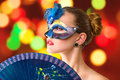 Beautiful young woman in venetian mysterious carnival mask fashion photo Royalty Free Stock Photo