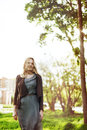 Beautiful young woman walking in the city park. Summer, wind. Royalty Free Stock Photo