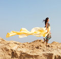 Beautiful young woman walking desert Stock Photos