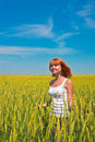 Beautiful young woman walking at wheat field Royalty Free Stock Images