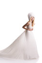 The beautiful young woman in a wedding dress posing Royalty Free Stock Image
