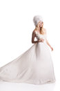 The beautiful young woman in a wedding dress posing Stock Photo