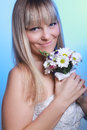 Beautiful young woman in a white dress with a bouquet of flowers Royalty Free Stock Photo