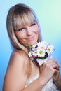 Beautiful young woman in a white dress with a bouquet of flowers Stock Images