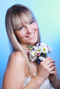 Beautiful young woman in a white dress with a bouquet of flowers Royalty Free Stock Photography