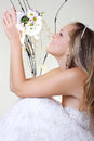 Beautiful young woman in a white dress with a bouquet of flowers Royalty Free Stock Image