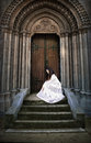 Beautiful young woman in white dress at church stairs. Book cover. Royalty Free Stock Photo