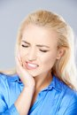 Beautiful young woman wincing in pain Royalty Free Stock Photo