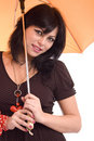 Beautiful young woman witn an orange umbrella Stock Photography