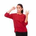 Beautiful young woman with wondering gesture portrait of on red blouse looking at you while standing on isolated white background Royalty Free Stock Image