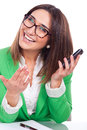Beautiful young woman at work holding a phone and smiling Stock Photo