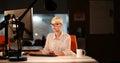 Woman working on computer in dark office