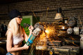 Beautiful young woman working with the grinder Royalty Free Stock Photo