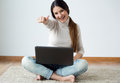 Beautiful young woman working on her laptop at home. Royalty Free Stock Photo