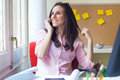 Beautiful young woman working in her office. Royalty Free Stock Photo