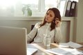 Beautiful young woman working from home businesswoman looking at laptop and thinking caucasian female in office Royalty Free Stock Photo