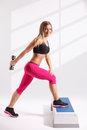 Beautiful young woman working out with dumbbell Royalty Free Stock Image