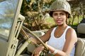 Beautiful young woman with ww2 military helmet Royalty Free Stock Photo