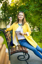 Beautiful young woman in yellow coat Royalty Free Stock Photo