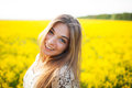 Beautiful young woman of yellow wildflowers in summer Stock Images